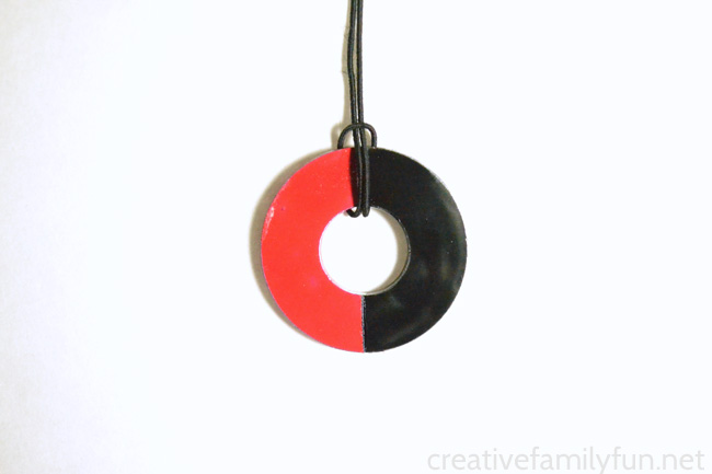 Make a DIY washer necklace with your school colors for your next School Spirit Day. It's a great craft for tweens and makes a great gift too.