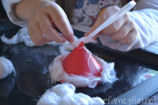 Make a simple Santa Hat Ornament to hang on your Christmas tree this year when you create this simple Christmas craft for kids.