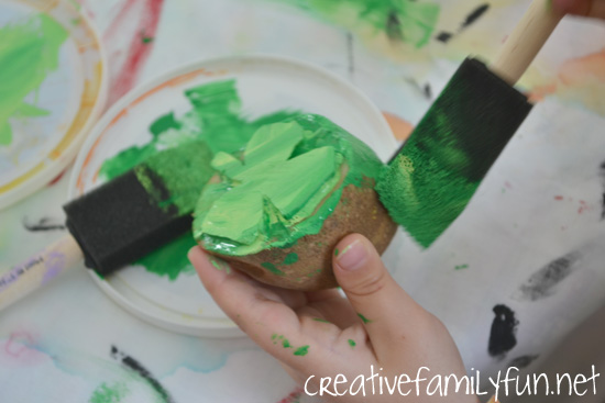 Use shamrock potato prints to decorate cards, paper, or notebooks with this fun printmaking project for St. Patrick's Day. It's a fun art project for all ages.