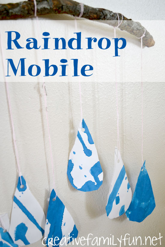 Use liquid watercolors and drip painting to make a beautiful mobile. This raindrop kids craft is a fun spring art project and perfect for a rainy day.