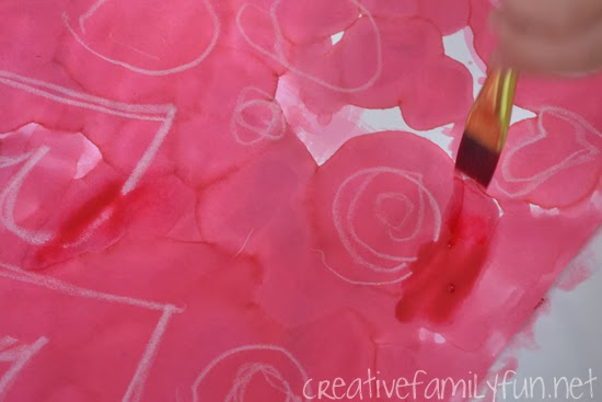 Make beautiful Valentine's Day kid art with a fun technique. These Valentine watercolor resist paintings are a fun process art project for February.