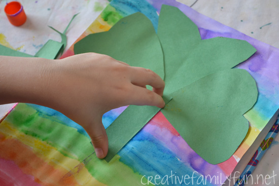St. Patrick's Day isn't just about the color green, it's all colors of the rainbow especially when you create this pretty Shamrock Rainbow Craft for Kids.