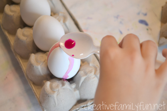 Decorate your Easter eggs this year with a fun twist on classic egg dying. This Easter Egg Dye Pour Painting is so much fun and results in pretty striped Easter Eggs.