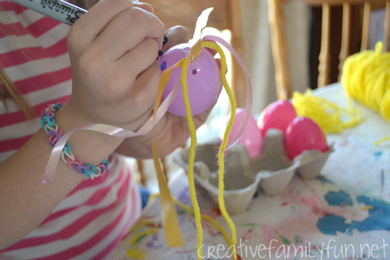 Turn your plastic Easter eggs into fun bunnies and cute kids. This fun kids craft is open-ended and creative. Try this fun activity, Plastic Egg Bunnies, this Easter.