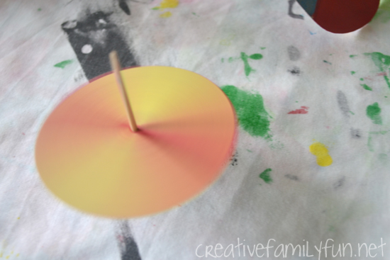 Use these fun spinning tops as a lesson in color with this color mixing STEM activity. It's so fascinating to watch the colors mix while they spin!