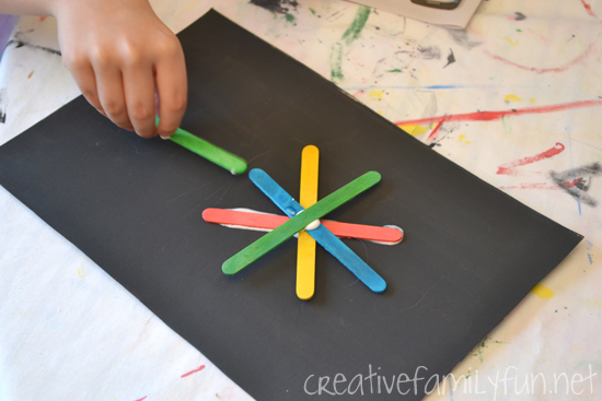 Grab a pile of colorful craft sticks and start creating this craft stick collage. You'll love the results of this craft stick art project for kids.