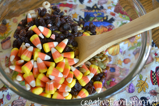 Make a simple and delicious Candy Corn Snack Mix to pair with a fun Halloween book. It's a great snack that kids can make themselves.