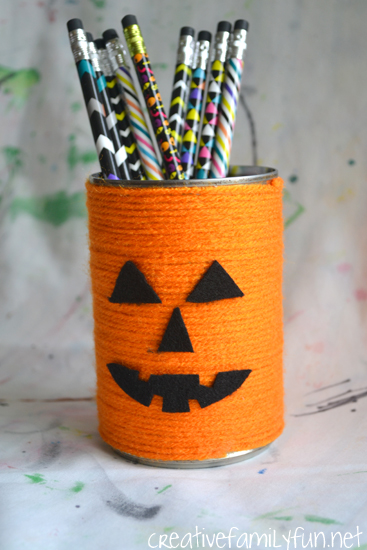 Store your Halloween pencils in this simple yarn wrapped Jack-O-Lantern Pencil Holder. It's a fun Halloween craft for kids and tweens.