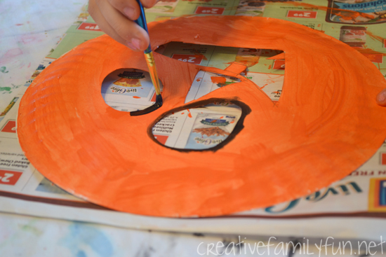 Grab some paper plates for this simple Halloween craft for kids: Paper Plate Jack-O-Lantern. It looks great hanging in a window!