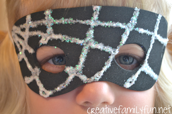 Make a simple glittery Spider Web Mask for kids out of craft foam. It's perfect for Halloween or everyday dress-up time. So much fun!
