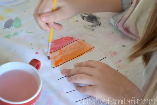 Get out your watercolors and make a pretty Easter banner. This simple Watercolor Easter Eggs Garland is simple to make, is a fun art project for kids, and make a pretty homemade Easter decoration.