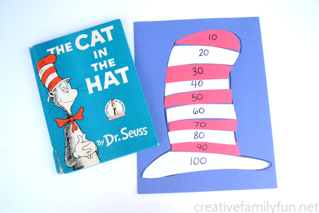 Practice skip counting by tens with this fun DIY math puzzle inspired by The Cat in the Hat by Dr. Seuss. It is such a fun math game.