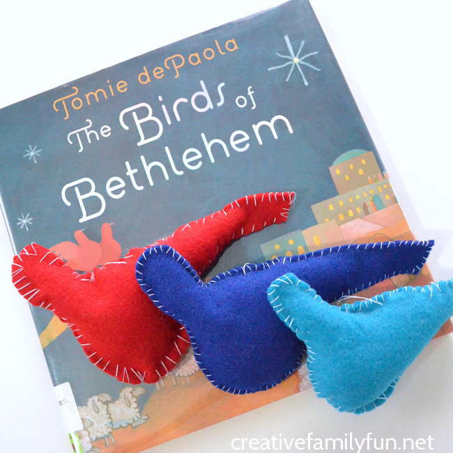Make simple felt bird ornaments inspired by the book The Birds of Bethlehem by Tomie dePaola. It's a simple sewing project for kids.