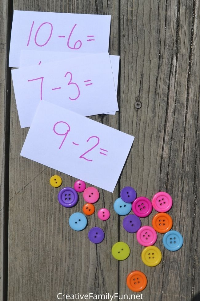 Subtraction using buttons as manipulatives