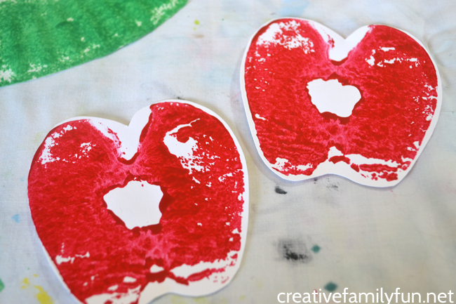 This fun Apple Print Wreath is a fun apple craft for kids to make this fall. It's a great craft for preschool and older kids and a fun fall decoration.