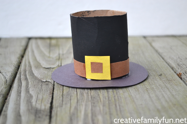 Use recycled craft materials to make this cute Cardboard Tube Pilgrim Hat Craft. It's an easy to make and fun Thanksgiving craft for kids.