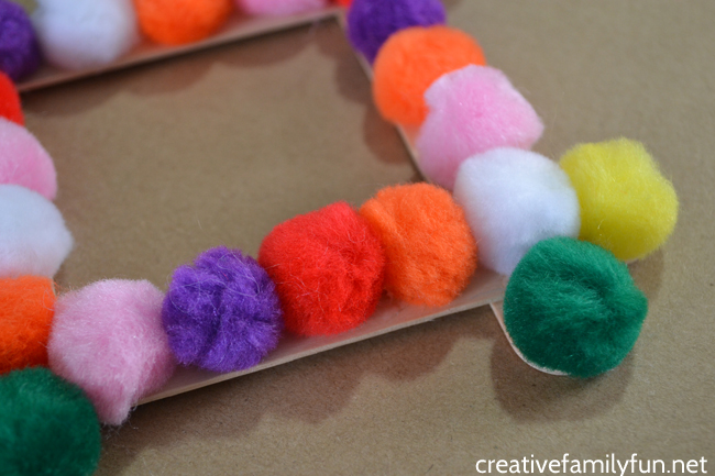 You can make this fun and simple pompom picture frame to display your favorite pictures in this easy craft for kids or tweens.
