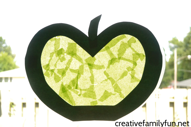 This simple stained glass apple suncatcher craft is fun to make for toddlers and preschoolers and will brighten your windows this fall.