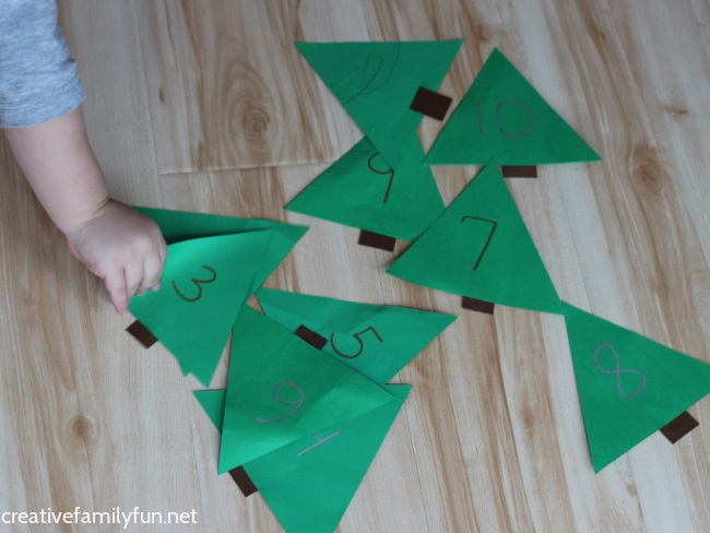 Have fun counting and learning number recognition with this fun and easy to prep Christmas tree number hunt activity for toddlers.