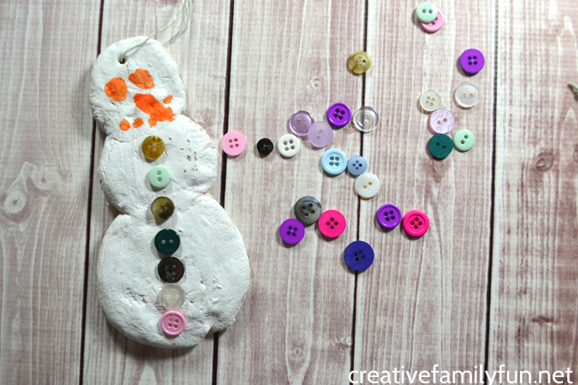 This Salt Dough Snowman ornament will make a great addition to your Christmas tree. This fun kids craft makes a great holiday keepsake.