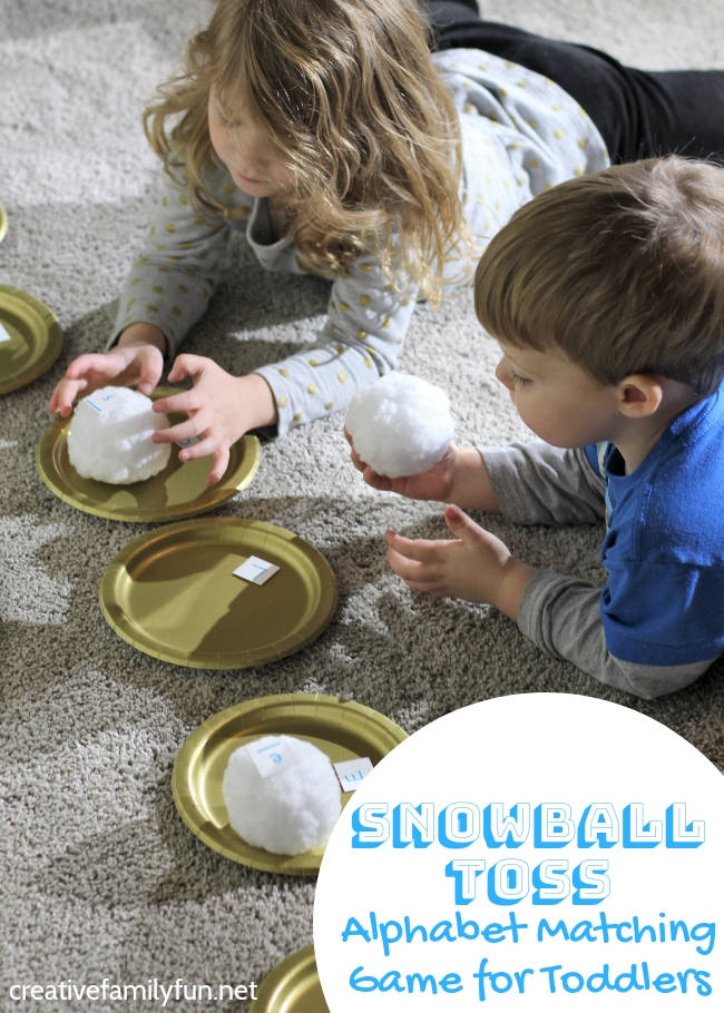 Learn your ABCs with this fun gross motor Snowball Throw Alphabet Game for Toddlers