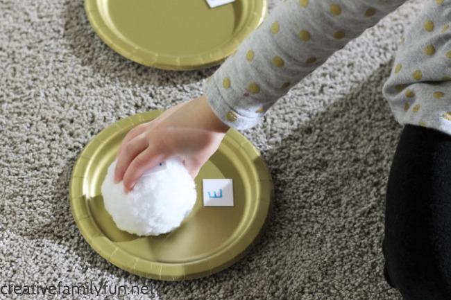 Your toddler or preschooler will have fun moving and learning their abc's with this simple gross motor Snowball Toss Alphabet Game