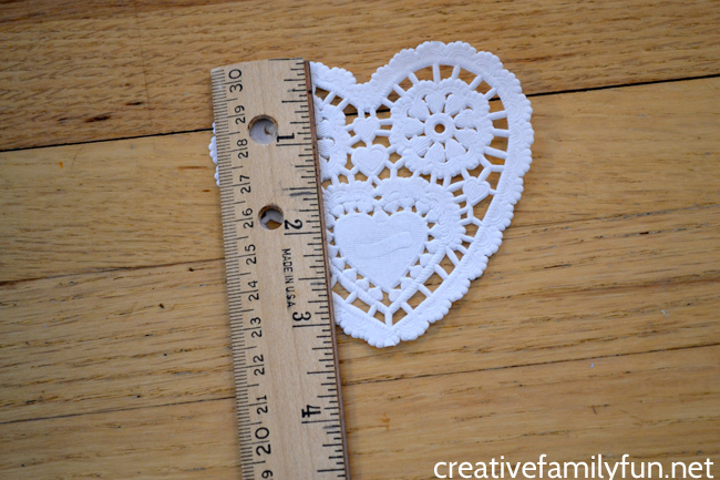 Use heart doilies for a fun hands-on way to practice measuring with this fun Valentine Nonstandard Measurement activity for kids.