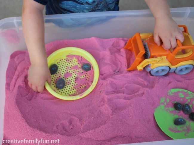 Have fun playing and learning your alphabet with this fun watermelon sensory sand activity with homemade alphabet rocks. It's a fun summer sensory activity!