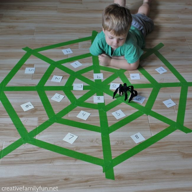 Practice number recognition with your toddlers when you play this fun Spider Toss Number Game.